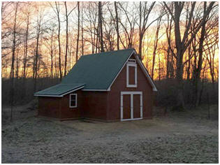 Sunset on a Candlewood Mini-Barn. Click to learn about inexpensive stock plans from architect Don Berg.
