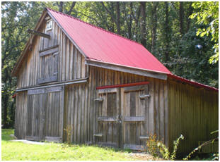This new pole-barn was built to look as if it was a hundred-year-old, traditional Maryland barn. It was built from inexpensive stock pole-barn plans by architect Don Berg