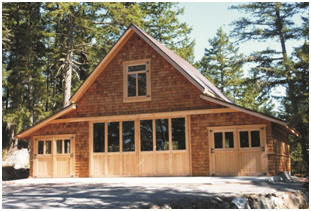 This custom Craftsman-Style four-car garage, in British Columbia was crafted with the help of inexpensive stock pole-barn plans by architect Don Berg.