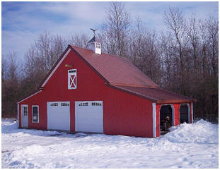 Here's a combination garage, shed and workshop in upstate New York. It's just one of fifteen  different layouts that you can build from the $59.00 Walnut Pole-Barn plan set by architect Don Berg