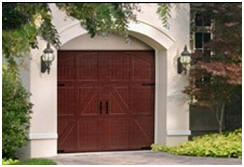 DoorsOn-Line.com Has great prices on carriage-house style garage doors, for do-it-yourself installation.